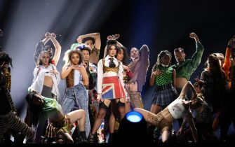 epa09192320 epa09192281 A handout photo made available by the Brit Awards shows Dua Lipa performing at the Brit Awards 2021 at the O2 Arena in Greenwich, Greater London, Britain, 11 May 2021. It is the 41st edition of the British Phonographic Industry's annual pop music awards.  EPA/JOHN MARSHALL / HANDOUT NO TV / NO USE AFTER 08 JUNE 2021 / MANDATORY CREDIT: JOHN MARSHALL HANDOUT EDITORIAL USE ONLY/NO SALES/NO ARCHIVES