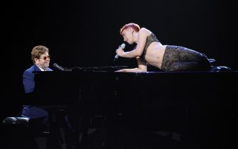 epa09192354 epa09192335 A handout photo made available by the Brit Awards shows Elton John (L) and Olly Alexander performing at the Brit Awards 2021 at the O2 Arena in Greenwich, Greater London, Britain, 11 May 2021. It is the 41st edition of the British Phonographic Industry's annual pop music awards.  EPA/JOHN MARSHALL / HANDOUT NO TV / NO USE AFTER 08 JUNE 2021 / MANDATORY CREDIT: JOHN MARSHALL HANDOUT EDITORIAL USE ONLY/NO SALES/NO ARCHIVES