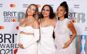 epa09192240 A handout photo made available by the Brit Awards shows members of the band Little Mix at the Brit Awards 2021 at the O2 Arena in Greenwich, Greater London, Britain, 11 May 2021. It is the 41st edition of the British Phonographic Industry's annual pop music awards.  EPA/JOHN MARSHALL / HANDOUT NO TV / NO USE AFTER 08 JUNE 2021 / MANDATORY CREDIT: JOHN MARSHALL HANDOUT EDITORIAL USE ONLY/NO SALES/NO ARCHIVES