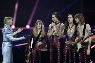 ROTTERDAM, NETHERLANDS - MAY 22: (L-R) Presenter Chantal Janzen presents the trophy to Victoria De Angelis, Damiano David, Ethan Torchio and Thomas Raggi of MÃ¥neskin from Italy for the winning song â  Zitti e buoniâ   (Shut Up And Be Quiet) during the 65th Eurovision Song Contest grand final held at Rotterdam Ahoy on May 22, 2021 in Rotterdam, Netherlands. (Photo by Dean Mouhtaropoulos/Getty Images)