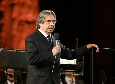 Italian conductor Riccardo Muti speaks as he arrives to  conduct the Luigi Cherubini Youth Orchestra and nine musicians from the Syrian diaspora in Europe, as part of the 24th friendship concert, at the Paestum archaeological site in southern Italy, on July 5, 2020. - The concert is dedicated to Syrian archaeologist Khaled al-Asaad and Kurdish-Syrian political leader Hevrin Khalaf, who were killed during the ongoing civil war in Syria. Khalaf was killed by Turkish-backed Syrian fighters in 2019, and al-Assad, Palmyra's chief archaeologist, was beheaded by Islamic State (IS) jihadists after they captured the ancient city in 2015. (Photo by Vincenzo PINTO / AFP) (Photo by VINCENZO PINTO/AFP via Getty Images)