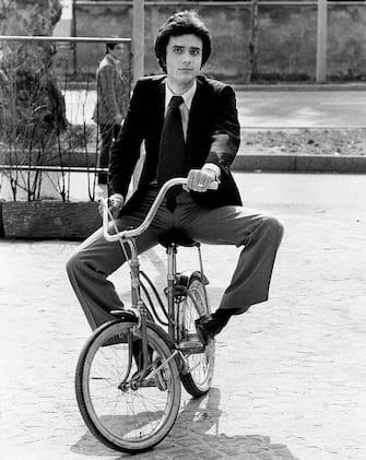 Portrait of the Italian singer Giovanni Nazzaro (known as Gianni Nazzaro) on a bicycle wearing jacket and tie. Milan (Italy), 1971.. (Photo by Rino Petrosino/Mondadori via Getty Images)