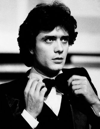 Close-up of the Italian singer Giovanni Nazzaro (known as Gianni Nazzaro) while strightening his bow tie in the grand finale night of the popular TV broadcast Canzonissima of 1973-74, conducted by Pippo Baudo and Mita Medici; Nazzaro sings the song titled Il cuore di un poeta and finishes eighth in the music contest. Rome (Italy), January 6th, 1974.. (Photo by Mario Notarangelo/Mondadori via Getty Images)