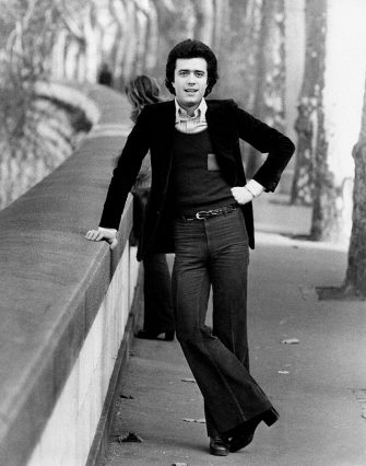 Full lenght portrait of the Italian singer Giovanni Nazzaro (known as Gianni Nazzaro) in a park leaning on a low wall. Rome (Italy), 1973.. (Photo by Rino Petrosino/Mondadori via Getty Images)