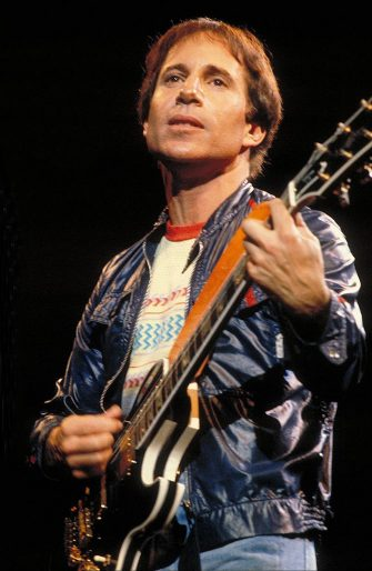 UNITED STATES - OCTOBER 01:  Photo of Paul SIMON; Paul Simon performing on stage  (Photo by Richard E. Aaron/Redferns)