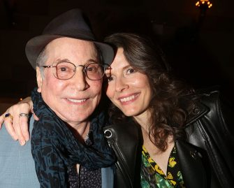"""NEW YORK, NY - MARCH 24:  (EXCLUSIVE COVERAGE) Paul Simon and wife Edie Brickell pose at the Opening Night After Party for the new musical """"Bright Star"""" on Broadway at Gotham Hall on March 24, 2016 in New York City.  (Photo by Bruce Glikas/Bruce Glikas/FilmMagic)"""