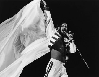 Singer Freddie Mercury (1946 - 1991) of British rock group Queen, performing on stage, 1986. (Photo by Dave Hogan/Hulton Archive/Getty Images)
