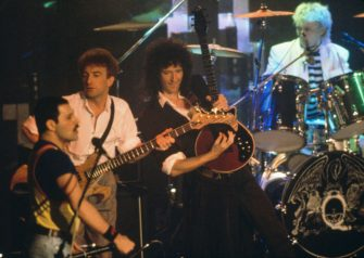 British rock group Queen performing on stage, 1986. Left to right: Freddie Mercury (1946 - 1991), John Deacon, Brian May and Roger Taylor. (Photo by Dave Hogan/Getty Images)