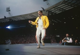 Singer Freddie Mercury (1946 - 1991) performing with Queen at Wembley Stadium, London, July 1986. The band played two nights at the venue, as part of the Magic Tour, on 11th and 12th July. (Photo by Dave Hogan/Getty Images)