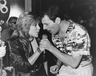 Singer Freddie Mercury (1946 - 1991) of Queen performs a duet with Samantha Fox during a party at Kensington Roof Gardens in London, 12th July 1986. The event is an after-party for Queen's sell-out Wembley concerts. (Photo by Dave Hogan/Getty Images)