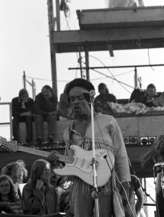 Jimi Hendrix performing his legendary 2 hour performance at Woodstock Music & Arts Festival held on Sam Yasgur's alfalfa field in Sullivan County in Bethal, New York on August 18, 1969. Hendrix insisted he close the festival and was scheduled to appear at midnight but due to delays did not take the stage until 9 am Monday morning. Most of the crowd had left for home by then and had dwindled from a whopping 500,000 to measly 80,000. ** HIGHER RATES APPLY ** CALL TO NEGOTIATE RATE ** © Peter Tarnoff / MediaPunch /IPX