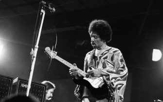 August 1970:  Influential rock guitarist Jimi Hendrix (1942 - 1970) in action at the Isle of Wight festival.  (Photo by Doug McKenzie/Getty Images)
