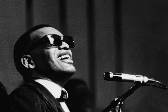 Musician Ray Charles performing at a microphone, c. 1960. (Photo by Express Newspapers/Getty Images)