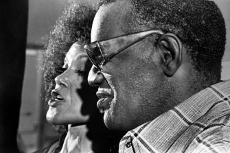 Ray Charles, the blind singer and musician singing with Cleo Laine, the jazz singer on the recording of the folk opera Porgy and Bess by George Gershwin, in 1976, July 1, 1976. (Photo by Afro American Newspapers/Gado/Getty Images)