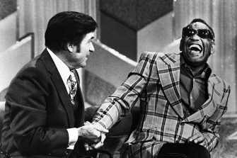 The co hosts of the television show, Mike Douglas television show, Mike Douglas and Ray Charles laughing during a live programme, February 15, 1979. (Photo by Afro American Newspapers/Gado/Getty Images)