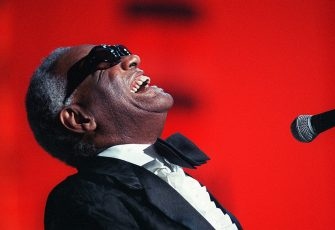 "(FILES) US musician and singer Ray Charles performs 30 June 1988 in Paris. Charles, legendary musician dubbed the ""Genius of Soul"" during an acclaimed six-decade career, died 10 June 2004 of complications from liver disease at the age of 73 in his Beverly Hills home. AFP PHOTO BERTRAND GUAY        (Photo credit should read BERTRAND GUAY/AFP via Getty Images)"