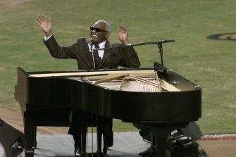 "28 Oct 2001:  Ray Charles performs ""America the Beautiful"" before the start of game two of the Major League Baseball World Series between the New York Yankees and the Arizona Diamondbacks at Bank One Ballpark in Phoenix, Arizona. DIGITAL IMAGE. Mandatory Credit: Jed Jacobsohn/ALLSPORT"