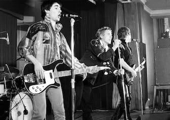 UNITED KINGDOM - NOVEMBER 15:  NOTRE DAME HALL  Photo of Steve JONES and Glen MATLOCK and Johnny ROTTEN and SEX PISTOLS, L-R: Glen Matlock, Johnny Rotten (John Lydon), Steve Jones performing live onstage  (Photo by Ian Dickson/Redferns)