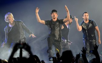 epa03209892 Singers Nick Carter (L-R), Brian Littrell, Alexander James (AJ) McLean and Howie Dorough of US boy band the Backstreet Boys perform together during their NKOTBSB Tour concert with US boygroup the New Kids on the Block at the o2 world in Berlin, Germany, 07 May 2012.  EPA/BRITTA PEDERSEN