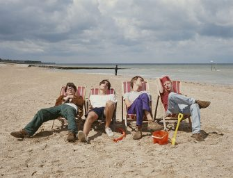 English alternative rock band Blur relax on a beach, circa 1995. From left to right, Graham Coxon, Alex James, Damon Albarn and Dave Rowntree. (Photo by Tim Roney/Getty Images)