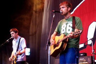 MOUNTAIN VIEW, CA - JUNE 13: Graham Coxon (L) and Damon Albarn of Blur perform as part of Live 105's BFD 1997 at Shoreline Amphitheatre on June 13, 1997 in Mountain View California. (Photo by Tim Mosenfelder/Getty Images)