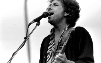 Bob Dylan on stage during his concert at Slane Castle, Co Meath, 08/07/1984 (Part of the Independent Newspapers Ireland/NLI Collection). (Photo by Independent News and Media/Getty Images)