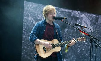epa04289805 British singer Ed Sheeran performs at the Pyramid Stage of the Glastonbury Festival of Contemporary Performing Arts 2014, held at Worthy Farm, near Pilton, Somerset, Britain, 29 June 2014. The outdoor festival runs from 26 to 30 June.  EPA/WILL OLIVER