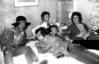 American rock guitarist Jimi Hendrix (1942 - 1970), bassist Noel Redding (1845 - 2001) and drummer Mitch Mitchell (1947 - 2008) of the Jimi Hendrix Experience with DJ Emperor Rosko (behind) and Lord Francis Russell (right) backstage at the Woburn Music Festival held at Woburn Abbey in Bedfordshire, England on July 06, 1968. (Photo by Michael Putland/Getty Images)