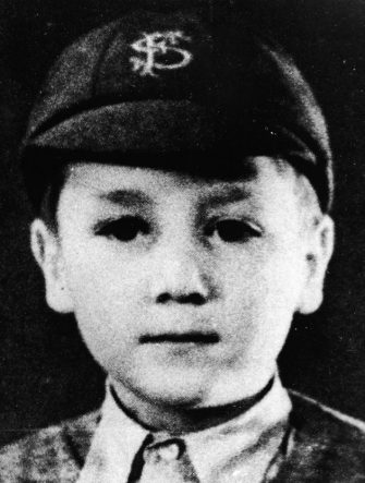 Headshot portrait of British musician and songwriter John Lennon (1940 -1980), of the pop group The Beatles, as a young boy in a school uniform and cap, c. 1948. (Photo by Pictorial Press/Getty Images)
