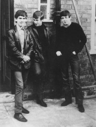 circa 1960:  Liverpudlian skiffle beat band The Beatles standing outside Paul's Liverpool home (left to right) George Harrison (1943 - 2001), John Lennon (1940 - 1980), Paul McCartney. Ringo Starr was not to join the band for another two years.  (Photo by Keystone/Getty Images)