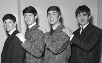 The Beatles, early group portrait, (L-R) Ringo Starr, Paul McCartney, John Lennon, George Harrison - posed, backstage, circa 1962. (Photo by Harry Hammond/V&A Images/Getty Images)