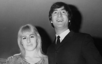 Musician, singer and songwriter John Lennon (1940 - 1980) of British rock group the Beatles with his first wife Cynthia during the launch of his book 'In His Own Write' at the Dorchester Hotel in London, 23rd April 1964. (Photo by Douglas Miller/Keystone/Hulton Archive/Getty Images)