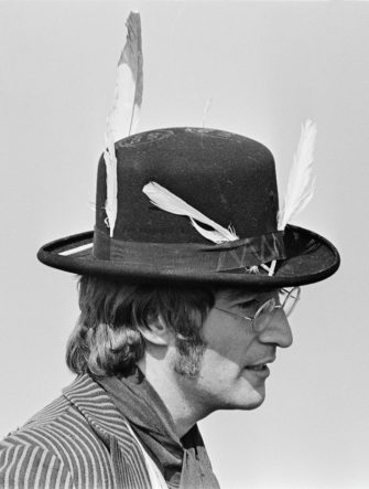 John Lennon (1940-1980), guitarist and singer with the Beatles, pictured wearing hat with feathers attached during filming of 'Magical Mystery Tour' in a field near Newquay in Cornwall on 14th September 1967. (Photo by Chapman/Daily Express/Hulton Archive/Getty Images)