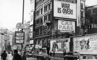 Among the posters for film and theatre at Piccadilly Circus in London is one from Beatle, John Lennon and his wife Yoko saying, 'War is Over ! If you want it. Happy Christmas from John and Yoko'.  (Photo by Alden Evening Standard/Getty Images)