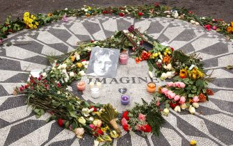 25th Anniversary memorial of the day John Lennon was shot, Strawberry Fields, 72 Street  Central Park West, NYC