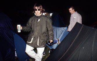 Liam Gallagher of Oasis backstage with brother Paul Gallagher, Glastonbury Festival, 1995. (Photo by Martyn Goodacre/Getty Images)