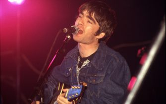 Noel Gallagher of Oasis performs on stage at The Electric Ballroom, Camden, London, United Kingdom, 9th May 1996. (Photo by Martyn Goodacre/Getty Images)