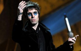 LONDON, ENGLAND - FEBRUARY 16:  Liam Gallagher throws his microphone into the audience after accepting Oasis' award for 'Best Album of 30 Years' on stage at The Brit Awards 2010 at Earls Court on February 16, 2010 in London, England.  (Photo by Gareth Cattermole/Getty Images)