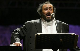 """Italian tenor Luciano Pavarotti performs with the Kremlin Presidential Orchestra in the Cypriot capital Nicosia 09 June 2004 as part of his world tour entitled """"Farewell to my Friends"""". The 67-year-old top tenor has decided to retire from his 40-year career in the coming two years. The east Mediterranean island of Cyprus is hosting a series of international cultural and musical events to mark its accession to the European Union last month. AFP PHOTO/Hasan MROUE        (Photo credit should read HASAN MROUE/AFP via Getty Images)"""