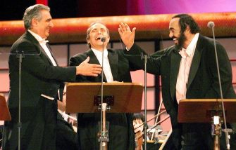 TOKYO, JAPAN:  Placido Domingo (L) of Spain, Jose Carreras (C) of Spain, and Luciano Pavarotti (R) of Italy share a laugh during the Three Tenors New Year Concert in Tokyo 09 January. More than 34,000 people enjoyed their performance.    (ELECTRONIC IMAGE)  AFP PHOTO (Photo credit should read TORU YAMANAKA/AFP via Getty Images)