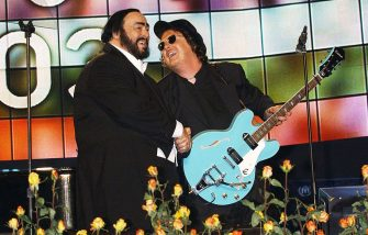 MODENA, ITALY - MAY 27:  (ITALY OUT) Luciano Pavarotti and Italian singer Zucchero Fornaciari (R) perform during the Pavarotti and Friends 2003 concert May 27, 2003 in Modena, Italy. This year's concert, the 10th edition of the Pavarotti and Friends benefits, will donate all the funds raised to help Iraqi refugees.  (Photo by Arnaldo Magnani/Getty Images)