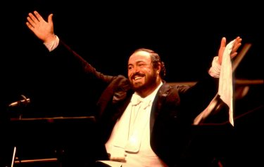 Luciano Pavarotti on stage at the Poplar Creek Music Theater in Hoffman Estates, Illinois, August 13, 1984. (Photo by Paul Natkin/Getty Images)