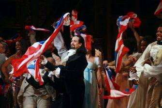 """SAN JUAN, PUERTO RICO - JANUARY 27:  Lin-Manuel Miranda and the cast of """"Hamilton"""" say goodbye to the audience at the end of the performance during the closing night of """"Hamilton"""" at Centro de Bellas Artes on January 27, 2019 in San Juan, Puerto Rico.  (Photo by Gladys Vega/Getty Images)"""