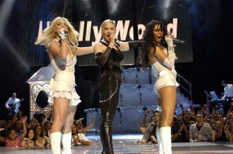 Britney Spears, Madonna and Christina Aguilera perform opening act at the 2003 MTV Video Music Awards (Photo by Kevin Mazur/WireImage)