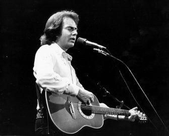 Aug 05, 1975 - London, England, United Kingdom - NEIL DIAMOND performs. Neil Leslie Diamond (born January 24, 1941) is an American singer-songwriter. Neil Diamond is one of pop music's most enduring and successful singer-songwriters. As a successful pop music performer, Diamond scored a number of hits worldwide in the 1960s, 1970s, and 1980s. c. late 1970s.
