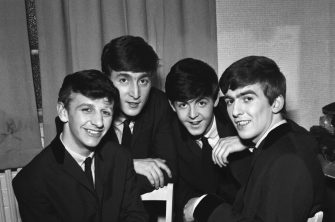 The Beatles pose for an eraly group portrait, backstage, (L-R) Ringo Starr, John Lennon, Paul McCartney, George Harrison, 1962. (Photo by Harry Hammond/V&A Images/Getty Images)