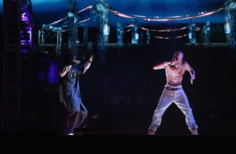 INDIO, CA - APRIL 15:  Rapper Snoop Dogg (L) and a hologram of deceased Tupac Shakur perform onstage during day 3 of the 2012 Coachella Valley Music & Arts Festival at the Empire Polo Field on April 15, 2012 in Indio, California.  (Photo by Christopher Polk/Getty Images for Coachella)