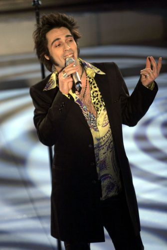 """SAN REMO, ITALY - MARCH 1:  Italian  singer Francesco Sarcina of the """"Le Vibrazioni""""Arigliano performs at the first day of the San Remo Festival at the Ariston Theatre on March 1, 2005 in San Remo, Italy. The five-day singing competition, organised by Rai Television, has welcomed such stars as Tina Turner, Peter Gabriel, and Andrea Boccelli in the past. Last year's festival was shrouded in controversy because Tony Renis, a close friend of Silvio Berlusconi, recently appointed artistic director of the festival, allegedly has close links with the Mafia. An alternative festival, the Mantova Musica Festival, was organised in protest at his appointment. (Photo by Giuseppe Cacace/Getty Images)"""