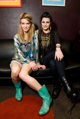 LOS ANGELES, CA - APRIL 01:  Musicians Leisha Hailey (L) and Camila Grey of Uh Huh Her pose backstage before their performance at The El Rey Theatre on April 1, 2011 in Los Angeles, California.  (Photo by Amanda Edwards/Getty Images)