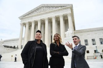 US actress and LGBTQ+ advocate Laverne Cox(C), actress Sara Ramirez and attorney Chase Strangio(R) pose as demonstrators in favour of LGBT rights  rally outside the US Supreme Court in Washington, DC, October 8, 2019, as the Court holds oral arguments in three cases dealing with workplace discrimination based on sexual orientation. (Photo by SAUL LOEB / AFP) (Photo by SAUL LOEB/AFP via Getty Images)